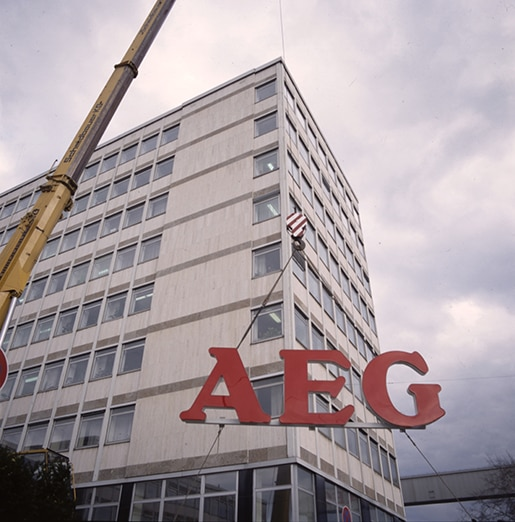Mounting-of-the-AEG-sign-history-stories